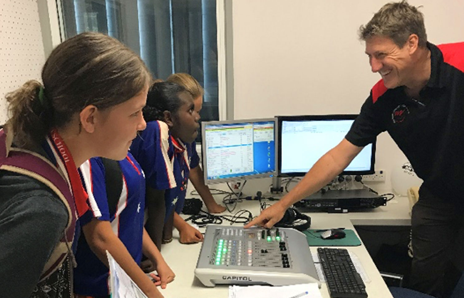 The girls talking over the console